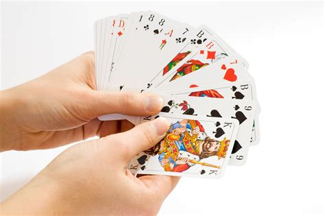 Hand Holding A Bunch Of Playing Cards Image