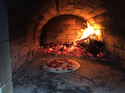 smith  family wood fired outdoor brick pizza oven
