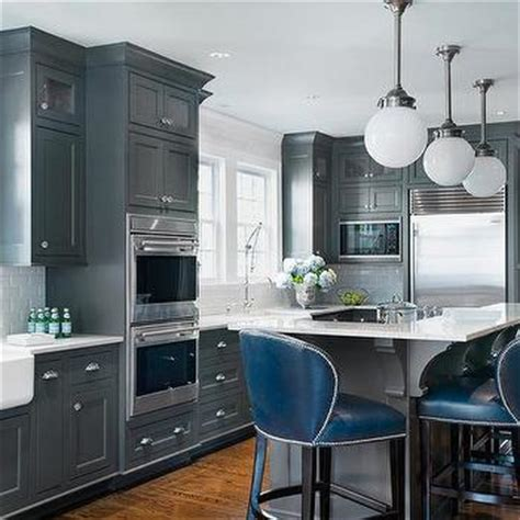 dark gray center island  deep blue leather counter stools transitional kitchen porters