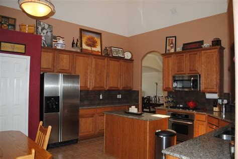 green kitchen walls accent wall in kitchen with brown cabinets 1453