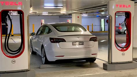 View What Does A Tesla 3 Cost Pics
