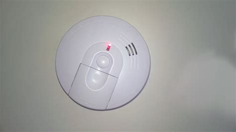 first alert smoke alarm blinking red light replacing hard wired fire alarms orbited by nine dark moons