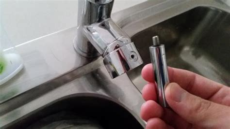 removing stuck handle from faucet mixer tap