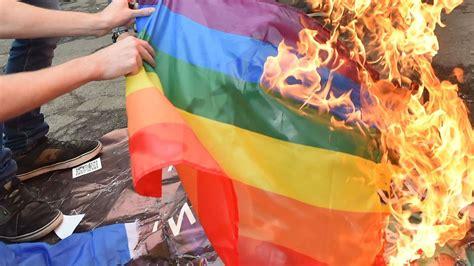 rainbow flag burned  baltimore lgbtq shop owner