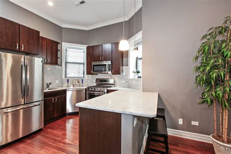 cherry floors gray walls dark cabinets with light counter tops kitchen in 2019 grey