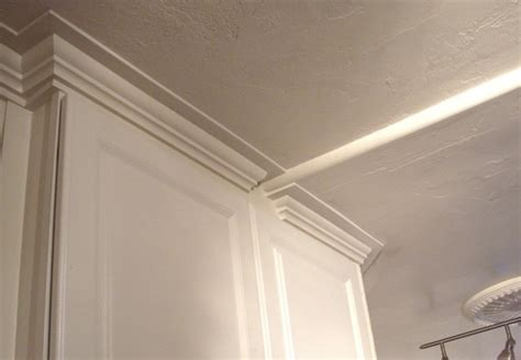 crown moulding above kitchen cabinets how to design and install an improvised kitchen crown 8513
