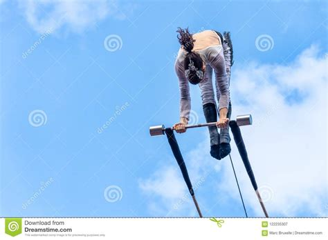 trapeze artist performing  editorial photography