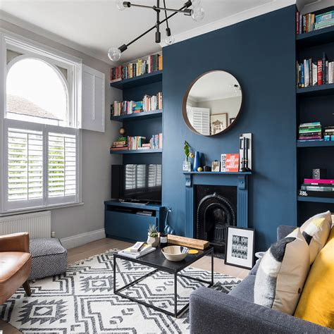 living room makeover featuring farrow ball stiffkey blue