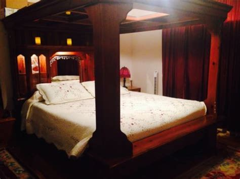 solid wood king canopy bed  mirrored ceiling