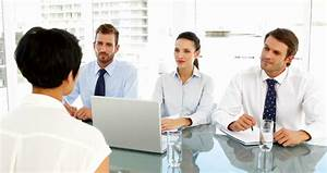 Interview Panel Talking To Applicant In The Office Stock