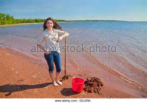 Woman Digging with Shovel