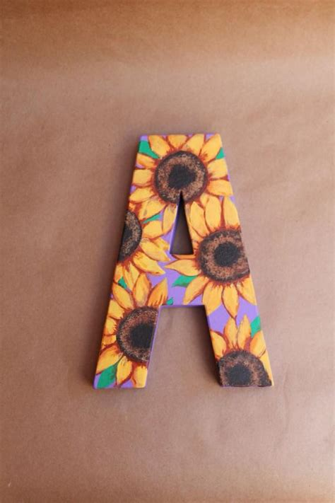 items similar  hand painted sunflower monogram paper mache letters nursery home decor  etsy