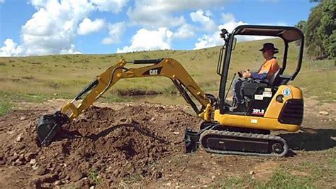 demo   versatile caterpillar  mini excavator youtube