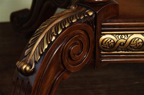 quality mahogany and walnut table with intricate inlay detail lazy susan echos the dining table with mahogany and walnut inaly gold