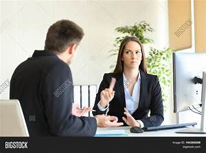Boss denying something saying no with a finger gesture to ...