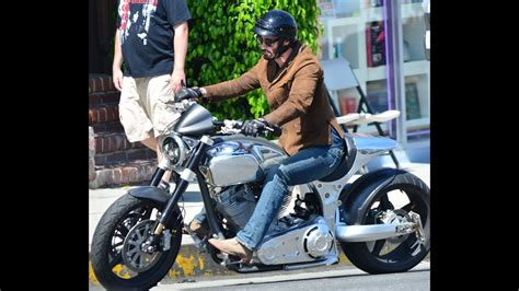 2014 Keanu Reeves Rides A Fancy Chrome Motorcycle With