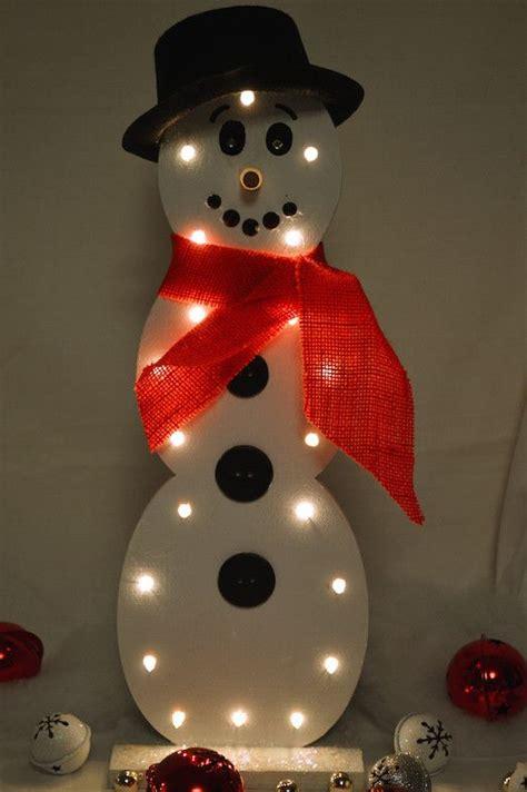 white light snowman wooden snowmen mouths  black