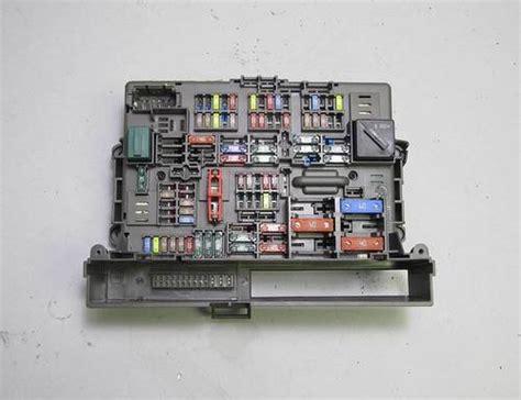 bmw    series  front interior glove box fuse box    oem prussian motors