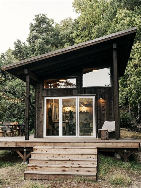 diy tiny home  slanted roof lots  windows  wide deck   tiny house cabin dome
