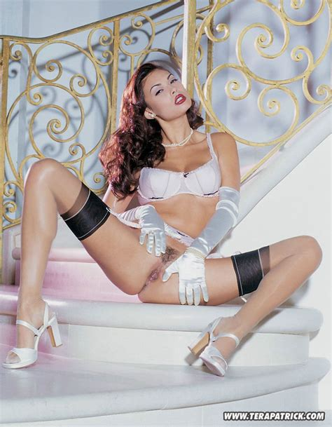 Glamorous beauty with flawlessly trimmed pussy wears black stockings and white garter belt