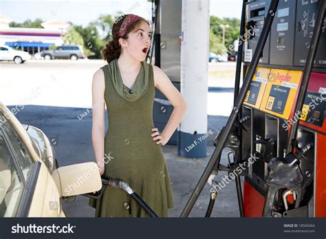 Young Woman Filling Her Gas Tank Stock Photo 18560464