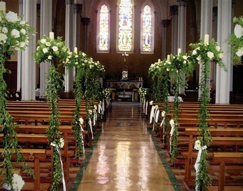 church wedding decorations white roses  ruscus