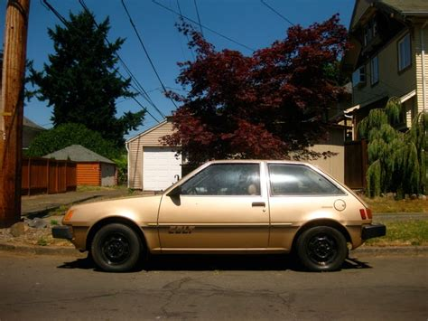 hatchback cars 1980s old parked cars 1980 dodge colt hatchback