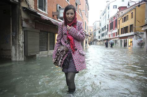venice hit  floods  heavy rains  strong winds
