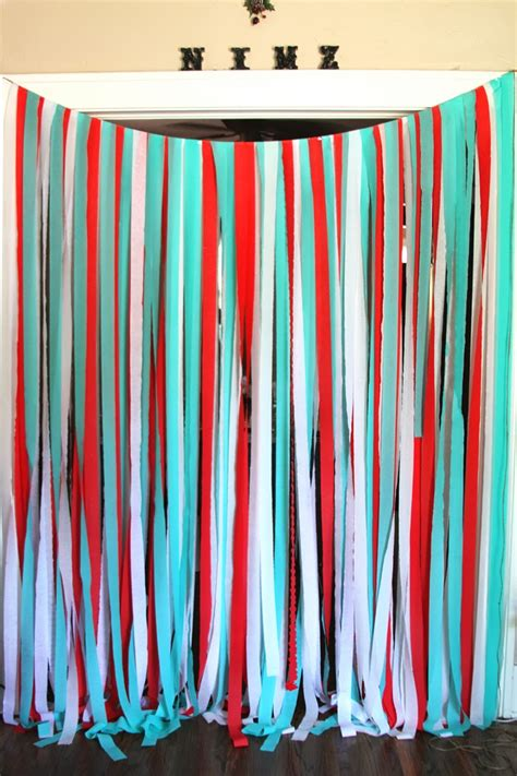 Ditch that can of paint and get creative with fun wall decor instead! DIY: Party Streamer Wall by Marilyn - Brewed Together