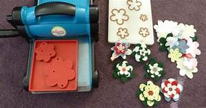 here is what you need to creat your felt flowers i made With machine to cut fabric letters