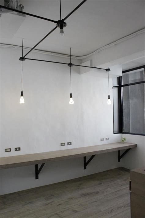 small office lighting ideas include workbench with high stools in reception area for