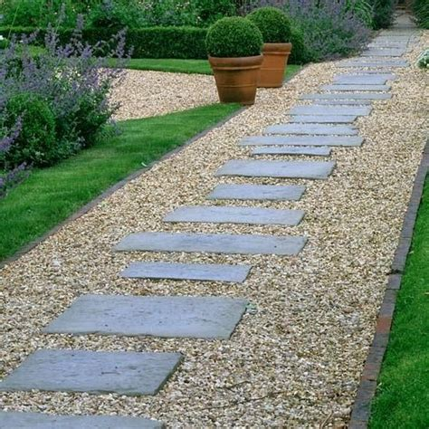 gravel sidewalk ideas pea gravel lined with brick and pavers in different sizes for stepping stones neat and tidy