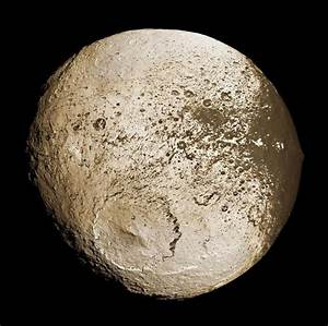 Iapetus, the third largest of the more than 60 moons of ...