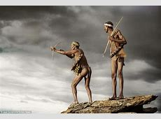 Fearless hunters from ancient tribe use bow and arrows