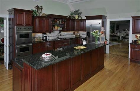 cherry wood kitchen cabinets with black granite cherry cabinets black appliances cabinetfacers inc 9804