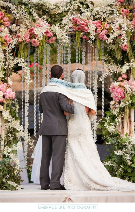 bride  groom wrapped  tallit   chuppah
