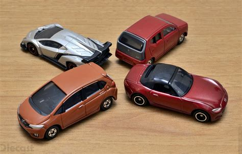 Tomica Die Cast Vehicles four tomica mini diecast models unboxed xdiecast