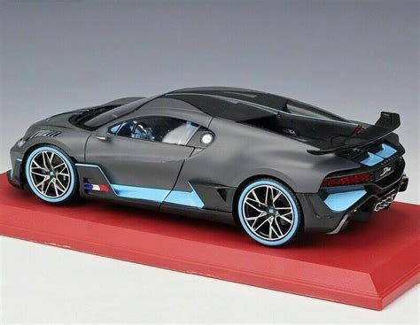 The giant box holding the hypercar inside had to be very specifically disassembled so that the divo could roll out. BUGATTI Divo 2018 Matt-Grey/Light Blue