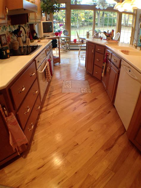 wood floors in kitchens designing your floor to make your kitchen feel bigger 1580