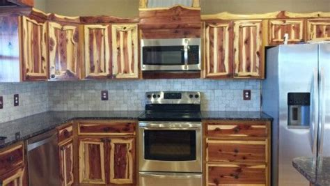 Rustic red cedar kitchen cabinets. Modern frontier log