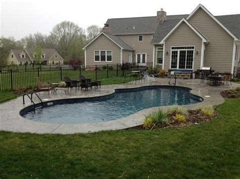 mountain lake shape in ground pool with sted concrete