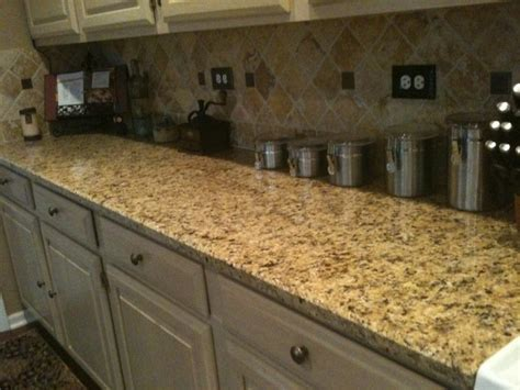 pictures of backsplashes for kitchens venetian gold granite countertop with travertine