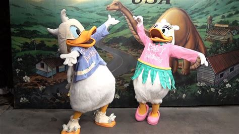 donald daisy duck dressed  dinosaurs meet guests