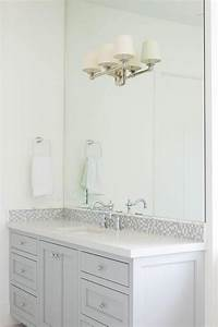 gray glass mosaic tiled backsplash transitional bathroom With bathroom vanity backsplash height