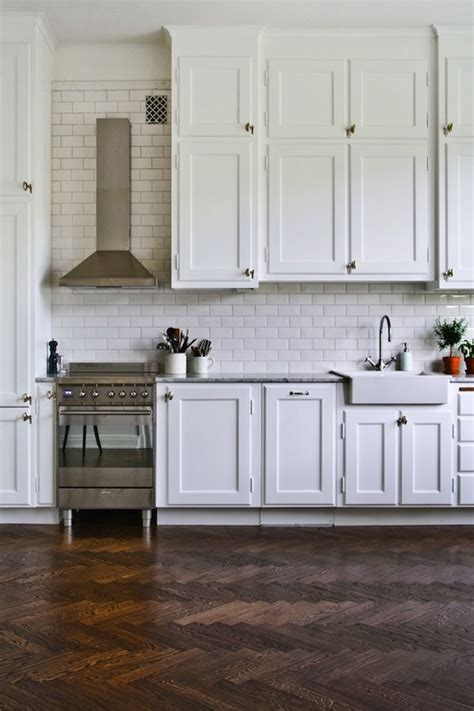 tile or wood floors in kitchen herringbone floors transitional kitchen byggfabriken 9469