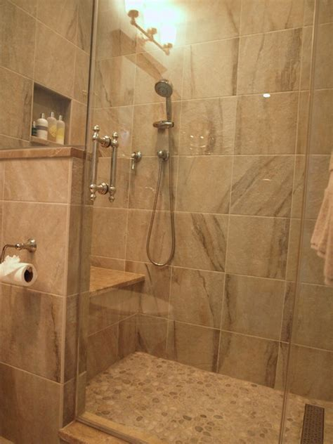 standup shower with river rock floor traditional