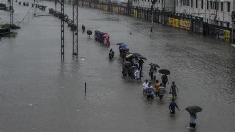 photos mumbai rains flights trains and buses resume as