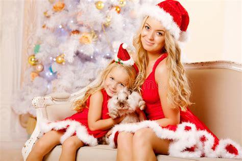 mom  daughter dressed  santa celebrate christmas