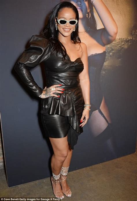 rihanna squeezes curves  tight leather dress sirkenayo