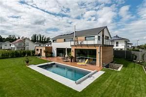 Moderne Häuser Mit Pool : fertigh user mit holz bauen plusenergiehaus ~ Markanthonyermac.com Haus und Dekorationen